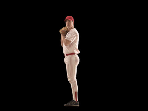 vídeos de stock, filmes e b-roll de baseball player pitching - this clip has an embedded alpha-channel - codificável
