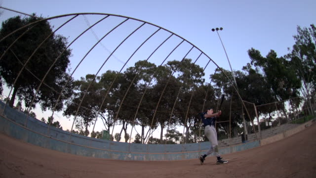 A baseball player practicing his swing.  - Slow Motion
