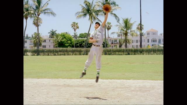 WS Baseball player practising on baseball field / United States