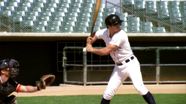 slo mo ms baseball player preparing to bat in stadium / lancaster, california, usa - 揺らす点の映像素材/bロール