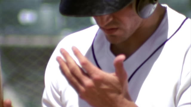 SLO MO CU TD TU Baseball player preparing to bat / Lancaster, California, USA