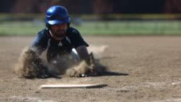 Baseball player slides into base, slow motion