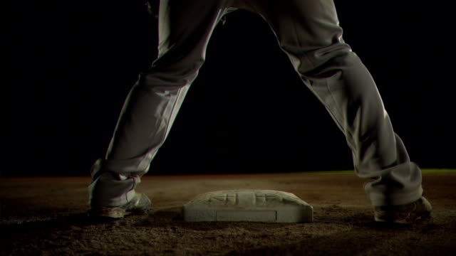 baseball player slides into third base - baseballspieler stock-videos und b-roll-filmmaterial