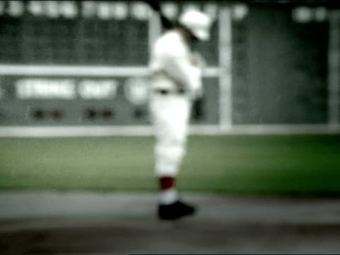 baseball player stands in front of a scoreboard. - inning stock videos & royalty-free footage