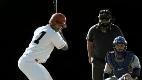 ms slo mo baseball player swinging bat and hitting ball / thousand oaks, california, usa - 1 minute or greater stock videos & royalty-free footage