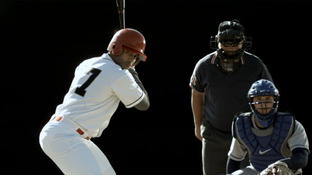 MS SLO MO Baseball player swinging bat and hitting ball / Thousand Oaks, California, USA