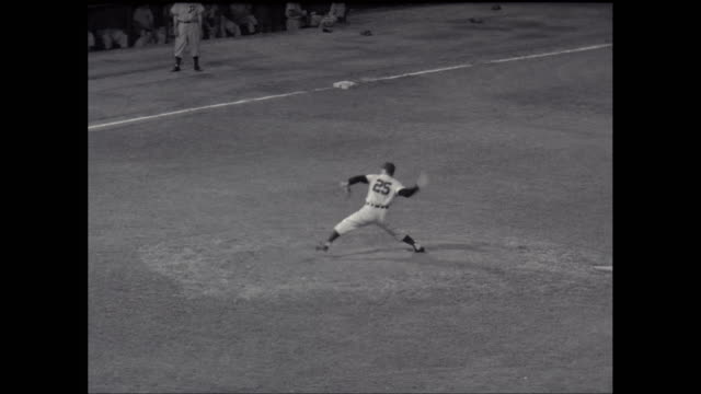 ms tu baseball player throwing baseball and running in baseball diamond / united states - baseball sport stock videos & royalty-free footage