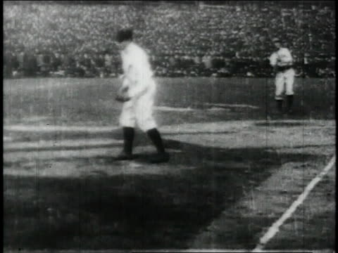 baseball players batting and catching / united states - 1913 stock-videos und b-roll-filmmaterial