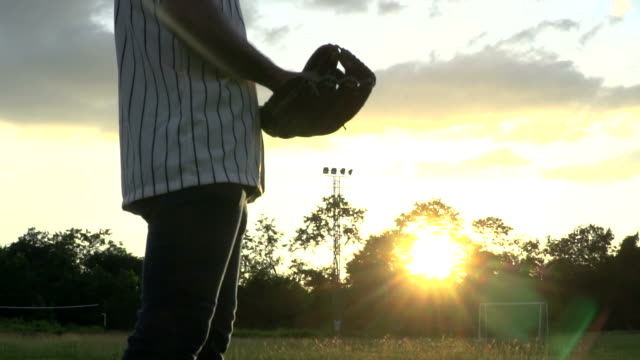 baseball players during practice in sunset - baseball sport stock videos & royalty-free footage