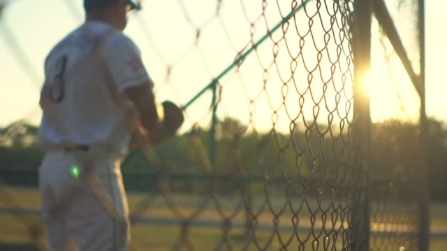 baseball players during practice in sunset - baseball player stock videos & royalty-free footage
