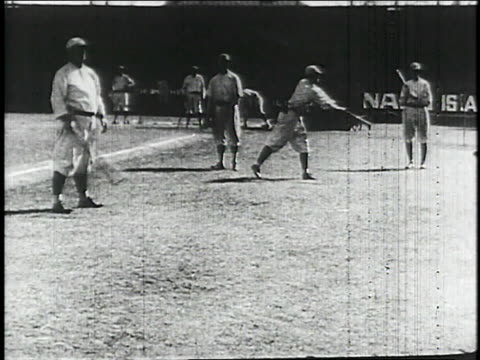 baseball players hitting and catching baseballs / united states - 1913 stock-videos und b-roll-filmmaterial