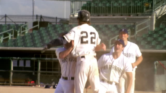 slo mo cu baseball players in home base / lancaster, california, usa - home run stock-videos und b-roll-filmmaterial