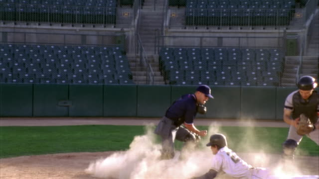 slo mo ms baseball players in home base / lancaster, california, usa - home run stock-videos und b-roll-filmmaterial