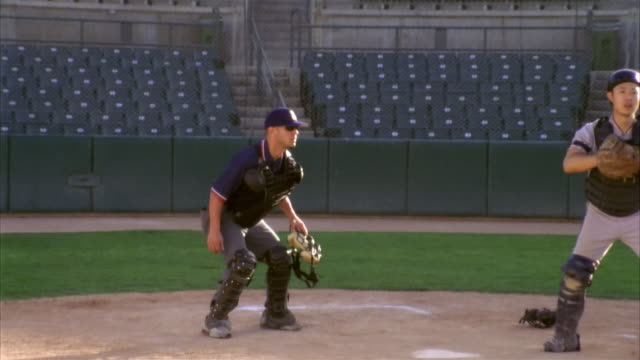 slo mo ms zi baseball players in home base / lancaster, california, usa - 滑る点の映像素材/bロール