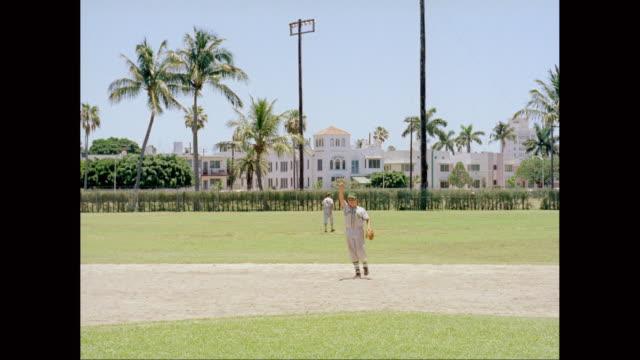 ws baseball players playing at baseball diamond / united states  - baseball player stock videos & royalty-free footage