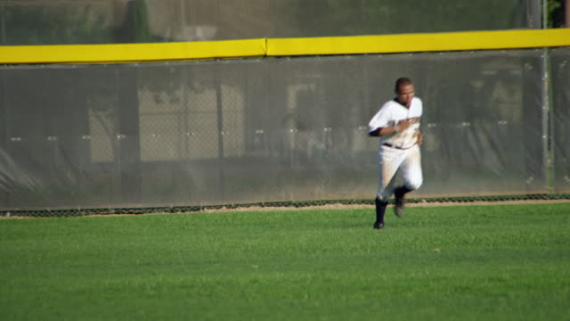 WS PAN Baseball players warmup running from outfield / Riverside, California, United States