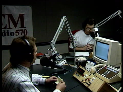 illinois: chicago: int cms radio interviewer in studio r-l to another speaking into microphone announcers in studio zoom in to earl forcey cms earl... - zoom out 個影片檔及 b 捲影像