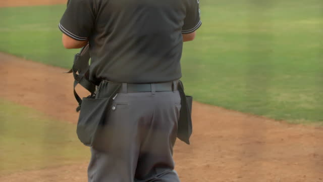 baseball umpire and players make a play at a game. - slow motion - number 7 stock videos & royalty-free footage