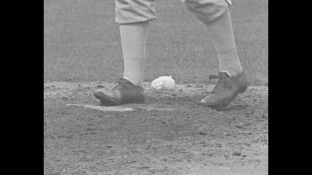 baseballs roll out of sack / baseball bats in on rack / player's foot sweeps dirt on pitcher's mound / various shots of pitcher's feet on mound going... - ticket counter stock videos & royalty-free footage