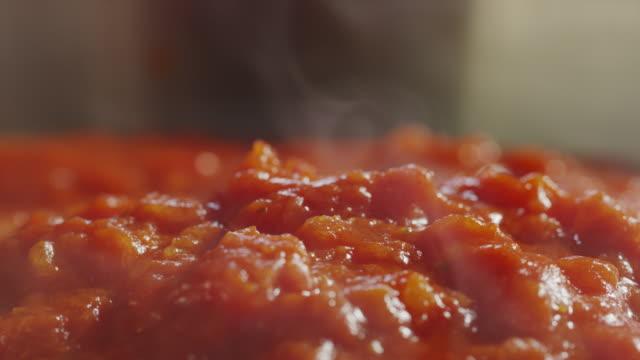 basil sprinkling on steaming hot tomato sauce / cedar hills, utah, united states - tomato sauce stock videos & royalty-free footage