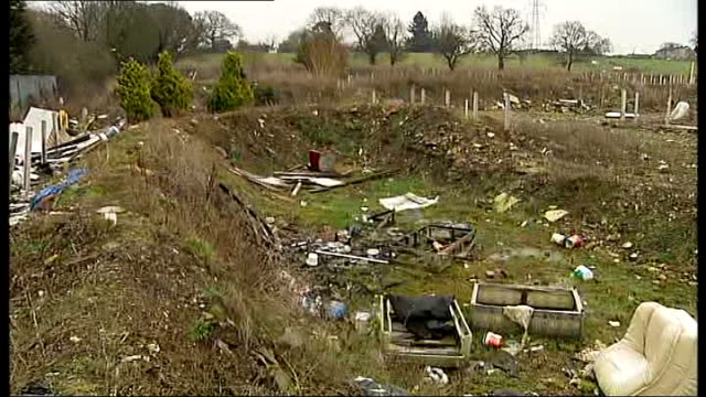 Basildon Council approve new travellers' camp half a mile from Dale Farm ENGLAND Essex EXT Furniture and debris dumped in ditch PAN Reporter to camera