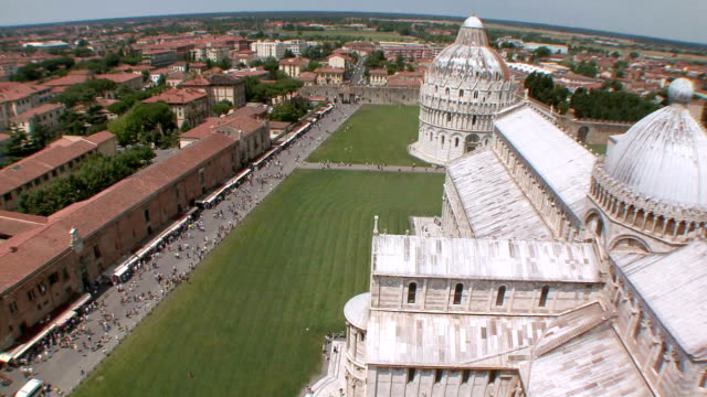ws td basilica and baptistry of st. john from leaning tower / pisa, tuscany, italy   - cattedrale video stock e b–roll