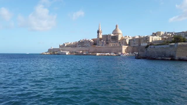 basilica of our lady of mount carmel , valletta cityscape in malta - malta stock videos & royalty-free footage