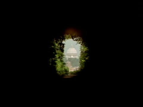 basilica of st. peter's through a keyhole - basilica stock videos and b-roll footage