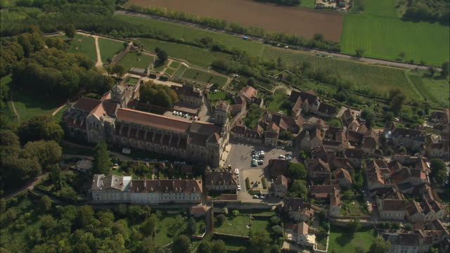 AERIAL WS ZO Basilique Ste-Madeleine and town with surrounding landscape / Vezelay, France
