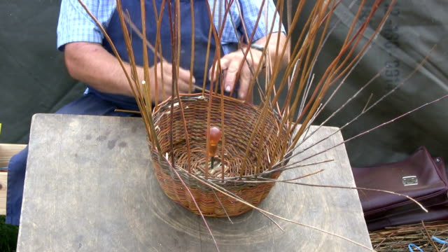 basket maker producing a round bag - basket stock videos and b-roll footage