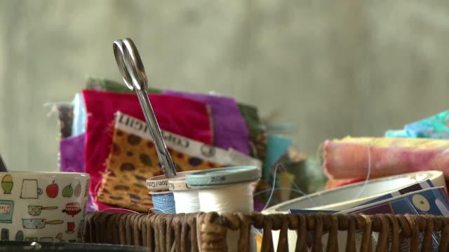 basket of fabrics, yarn, scissors - folded stock videos & royalty-free footage