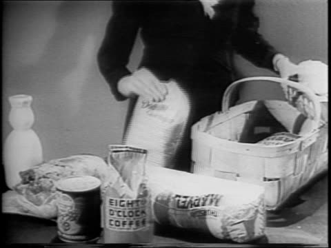 vidéos et rushes de basket of food on table / grocery store as car drives past / large department store / small 'tip-top' grocery store / packaged meat at store / woman... - panier courses