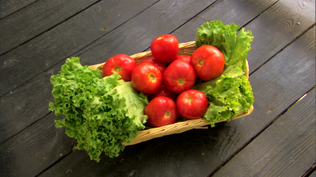 basket of fresh organic produce - see other clips from this shoot 1425 stock videos and b-roll footage