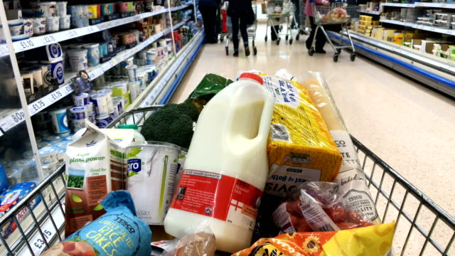 a basket of goods is seen in a supermarket on february 19 2018 in bristol england the governor of the bank of england mark carney has called for the... - インフレ点の映像素材/bロール