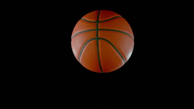 slo mo ld basketball ball bouncing on black surface - bouncing stock videos & royalty-free footage