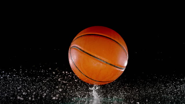 slo mo ld basketball bouncing off a wet surface - single object stock videos & royalty-free footage