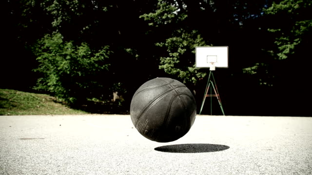 hd slow motion: basketball bouncing - basketball ball stock videos & royalty-free footage