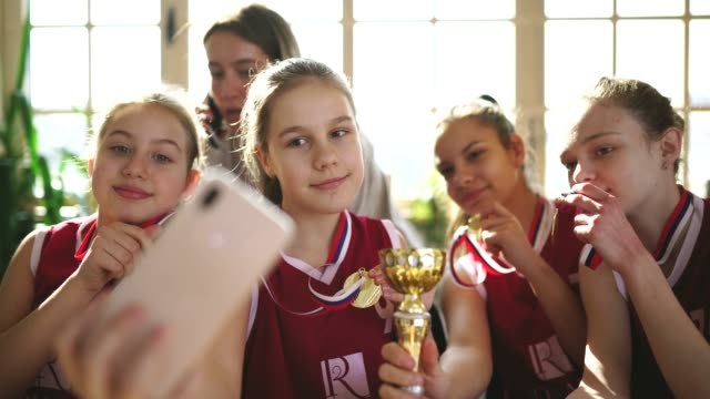 basketball champions making selfie with female coach - award stock videos & royalty-free footage