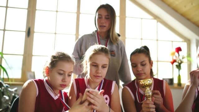 basketball champions making selfie with female coach - medallist stock videos & royalty-free footage