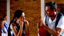 Basketball coach explaining to schoolgirl 4k