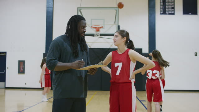 basketball coach talking to a player during practice - secondary school child stock videos & royalty-free footage