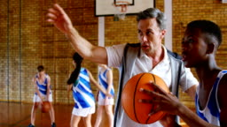 Basketball coach training to kid 4k