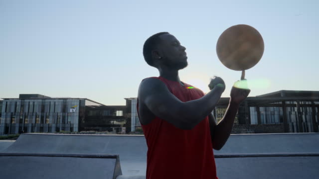 basketball expertly spinning a ball on his finger at sunrise - leisure games stock videos & royalty-free footage