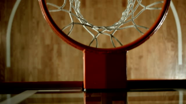 HD SLOW MOTION: Basketball Going Through A Hoop