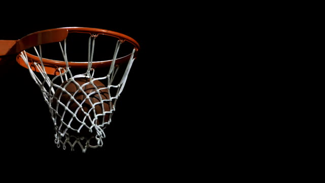 basketball going through a hoop (super slow motion) - basketball ball stock videos & royalty-free footage
