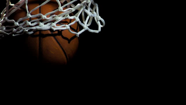 basketball going through a net (super slow motion) - basketball ball stock videos & royalty-free footage