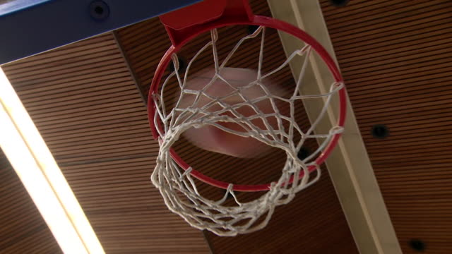 stockvideo's en b-roll-footage met basketball going through hoop - low angle view