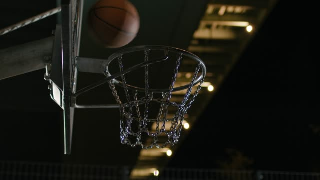basketball hitting on hoop at night - perso video stock e b–roll