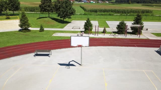 basketball hoop and court with shadows at sunset and shooting lines - event stock videos & royalty-free footage