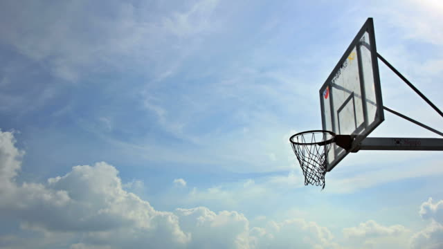 ms t/l basketball hoop behind cloudscape / seoul, south korea - basketball hoop stock videos and b-roll footage